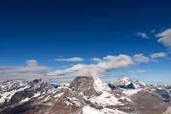 Winter panorama of mount Matterhorn covered with clouds, Canton of Valais. Alps, Switzerland stock image