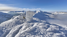 Winter panorama of mountains above the clouds Stock Photo