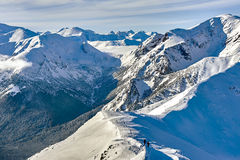 Winter panorama of mountains above the clouds. Royalty Free Stock Images