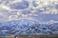Winter Panorama of Oquirrh Mountain range snow capped, which includes The Bingham Canyon Mine or Kennecott Copper Mine, rumored th. E largest open pit copper stock photo