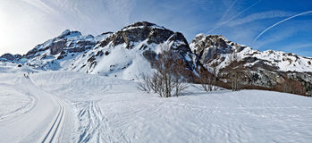Winter Panorama of Pyrenees at Somport ski resort. Winter Pyrenees Mountains of Somport ski resort with cross-country  passes in Spanish and French border. Light Royalty Free Stock Photo