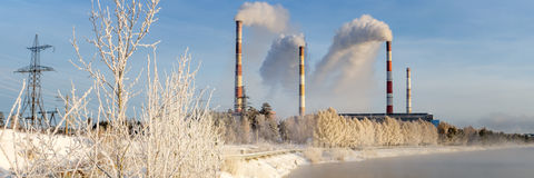 Winter panorama of Reftinskaya power plant with transmission lines and forest, Russia, the Urals, Stock Photography