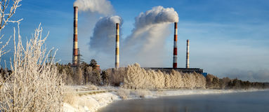 Winter panorama of Reftinskaya power plant with transmission lines and forest, Russia, the Urals, Royalty Free Stock Images