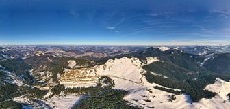 Winter panorama road in mountains royalty free stock photography