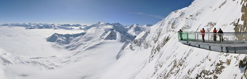 Winter panorama with skiers Royalty Free Stock Image