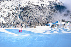 Winter panorama of the slopes at ski resort, snow trees, blue sky. Winter panorama of the slope at ski resort, snow pine trees Stock Image