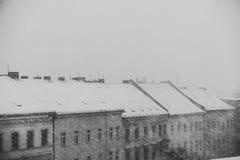 Winter panorama, snowing on city skyline Royalty Free Stock Image