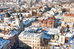 Winter panorama view from the Town Hall on the downtown in Lviv, Ukraine. Old buildings. Roofs covered with snow. Royalty Free Stock Images