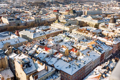 Winter panorama view from the Town Hall on the downtown in Lviv, Ukraine. Old buildings. Roofs covered with snow. Stock Photography