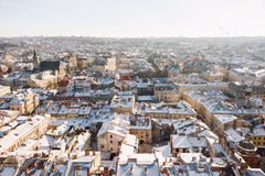 Winter panorama view from the Town Hall on the downtown in Lviv, Ukraine. Old buildings. Roofs covered with snow. Royalty Free Stock Image