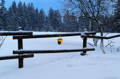 Winter panorama with yellow bucket hanging on the railing. Sonnenberg, Germany royalty free stock photography