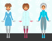 Winter paper dolls Stock Photos