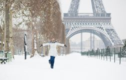 Winter in Paris. Happy young girl jumping Royalty Free Stock Photo