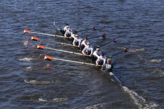Winter Park Crew races in the Head of Charles Regatta Men`s Youth Eight. BOSTON - OCTOBER 23, 2016: Winter Park Crew races in the Head of Charles Regatta Men`s Royalty Free Stock Photos