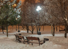 Winter park in the evening covered with snow. Winter park in the evening covered snow with a row of lamps Stock Images