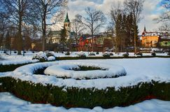 Park in winter. Winter park on the outskirts of the city at sunset Royalty Free Stock Photo
