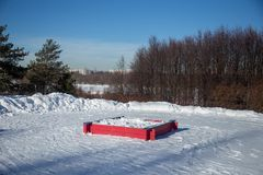 Sandbox with the snow in the park. Winter in the park. sandbox. Russia Stock Photos