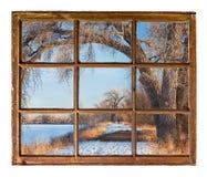 Winter park scene from old cabin window Stock Image