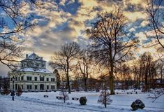 Park in winter. Winter park at sunset with historic building Royalty Free Stock Images