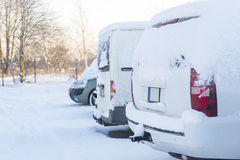 Winter parking lot with cars covered with snow Royalty Free Stock Photography