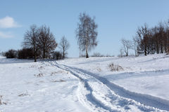 Winter path. Winter landscape with foot prints Royalty Free Stock Photography