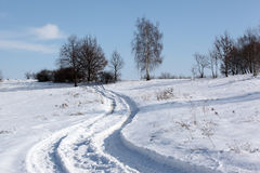 Winter path. Winter landscape with foot prints Royalty Free Stock Photos