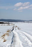 Winter path. Winter landscape with foot prints Royalty Free Stock Photo