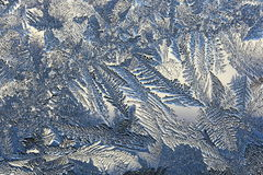 Winter pattern of ice crystals on glass Stock Photo