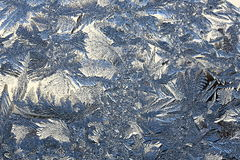Winter pattern of ice crystals on glass Royalty Free Stock Image