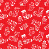 Winter pattern with mittens and socks. Winter red pattern with mittens and socks Royalty Free Stock Photos
