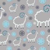 Winter pattern  sheep  snowflakes  gray background Royalty Free Stock Images