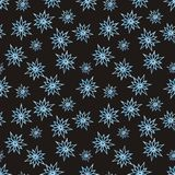 Winter pattern with snowflakes on a black background Royalty Free Stock Photos