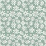 Winter pattern with snowflakes on a green background Stock Images