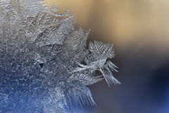 Winter patterns of ice on the window glass - macro Royalty Free Stock Images