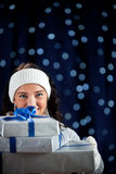 Winter: Peeking From Behind Stack of Gifts Stock Photo