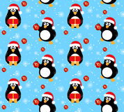 Winter penguin seamless pattern. Two cute penguins in winter Santa Claus hat on blue background with white snowflakes. Concept for Christmas and New year vector illustration