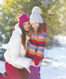 Winter and people concept - portrait of a mother and child Royalty Free Stock Photo