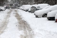 Winter. People walk on a very snowy sidewalk and road. People step on an icy pathway, icy sidewalk. Uncleaned streets and roads Stock Photo