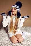 Winter photo of cute little girl with long blond hair wearing a hat and gloves. Fashion photo of cute little girl with long blond hair wearing a hat with Royalty Free Stock Photography