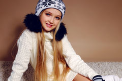 Winter photo of cute little girl whith long blond hair Stock Photo