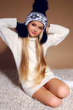 Winter photo of cute little girl whith long blond hair wearing a hat ang gloves Stock Photos