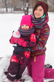 Winter photo mother and daughter. In park Stock Image