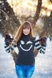 Beautiful girl in a beautiful day winter snow park Royalty Free Stock Photo