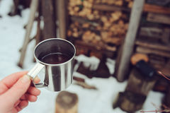 Winter picnic on the snow. Hot tea, thermos and snowball heart on cozy warm blanket. Outdoor seasonal activities Stock Photo