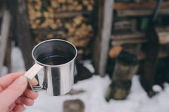 Winter picnic on the snow. Hot tea, thermos and snowball heart on cozy warm blanket. Outdoor seasonal activities Stock Image