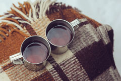 Winter picnic on the snow. Hot tea, thermos and snowball heart on cozy warm blanket. Outdoor seasonal activities Royalty Free Stock Images