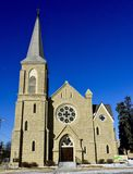 Holy Cross Church. This is a Winter picture of Holy Cross Catholic Church located in Batavia, Illimpis in Kane Coumty. This church is an example of Gothic Re stock images