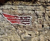The Piasa Bird. This is a Winter picture of the iconic replica of the Piasa Bird located on the limestone bluffs above the Mississippi River at Alton, Illinois royalty free stock photography