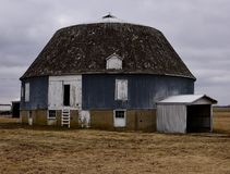 Auburn Round Barn. This is a Winter picture of an iconic Round barn located on a farm in Auburn, Illinois in Sangamon County.  This three-level framed Round barn Royalty Free Stock Photo