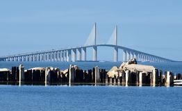 Sunshine Skyway Bridge From Manatee County. This is a Winter picture of the iconic Sunshine Skyway Bridge looming over old piling from the old bridge, as seen stock photos